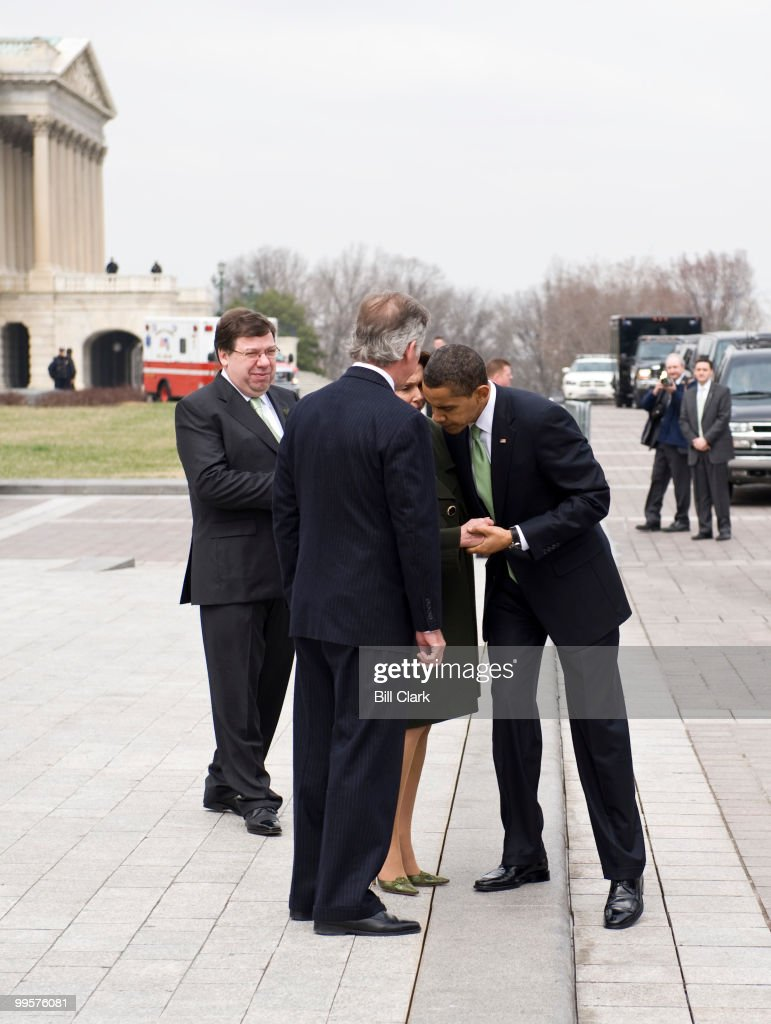 From left, Irish Taoiseach Brian Cowen, Rep. Richard Neal, D-Mass., and Speaker of the House Nancy Pelosi, D-Calif., say goodbye to President Barack Obama at the East Front Steps of the Capitol following the Annual St. Patrick's Day Luncheon on Tuesday, March 17, 2009.
