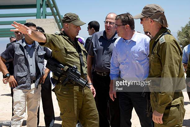 From left Israel Defense Forces 91st Division Commander Moni Katz directing his right arm forward Israeli Defense Minister Moshe Ya'alon US Defense...