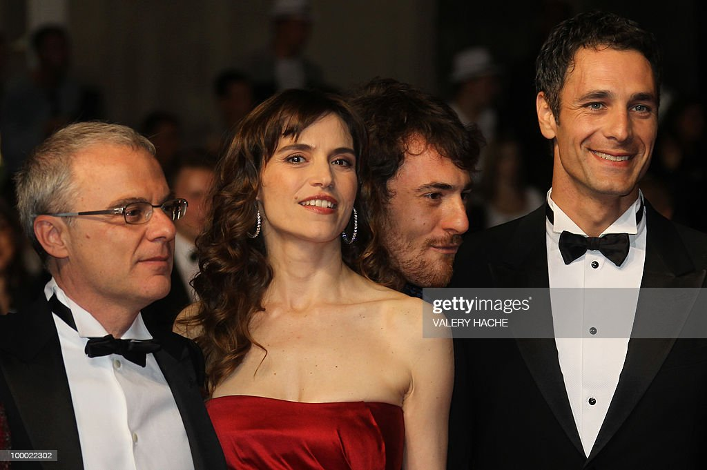 Italian director Daniele Luchetti, Italian actress Stefania Montorsi, Italian actor Elio Germano and Italian actor Raoul Bova arrive for the screening of 'La Nostra Vita' (Our Life) presented in competition at the 63rd Cannes Film Festival on May 20, 2010 in Cannes.