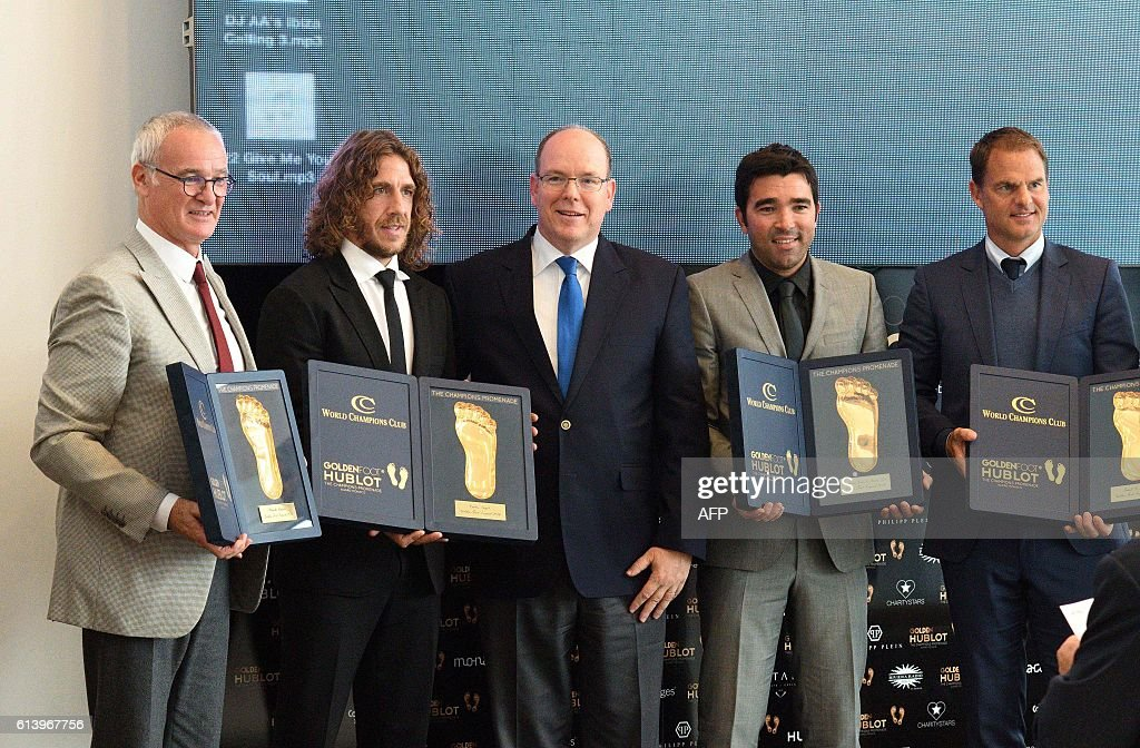 Italian football manager and former player Claudio Ranieri, Former Spanish football player Carles Puyol, Prince Albert II of Monaco, Anderson Luís de Souza, known as Deco, retired Brazilian born-Portuguese footballer, and Frank de Booer Dutch football manager of Inter Milan pose with their awards during the Golden Foot Award on October 11, 2016 in Monaco . / AFP / Yann COATSALIOU