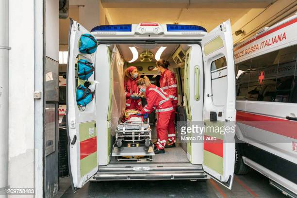 From left Italian Red Cross members Marta Paravano Monica Bonassoli and Giulia Cerutti check and prepare the ambulance before their shift on April 3...