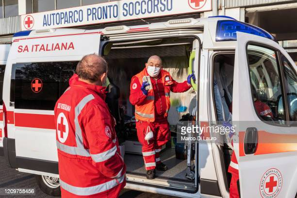 From left, Italian Red Cross members Stefano Spinedi and Marco Pezzotta check and prepare the ambulance before their shift on April 5, 2020 in...