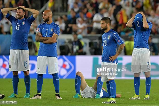 Italy's defender Andrea Barzagli Italy's forward Simone Zaza Italy's forward Lorenzo Insigne Italy's defender Mattia De Sciglio react after loosing...