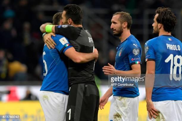 Italy's defender Andrea Barzagli Italy's goalkeeper Gianluigi Buffon Italy's midfielder Giorgio Chiellini and Italy's midfielder Marco Parolo react...