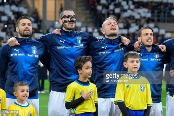 Italy's midfielder Antonio Candreva Italy's defender Leonardo Bonucci Italy's forward Ciro Immobile and Italy's midfielder Alessandro Florenzi sing...