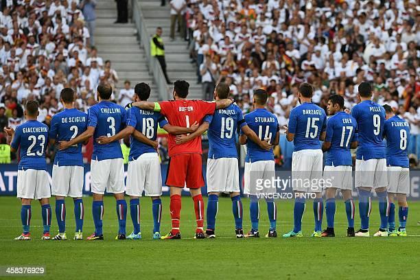 Italy's midfielder Emanuele Giaccherini Italy's defender Mattia De Sciglio Italy's defender Giorgio Chiellini Italy's midfielder Marco Parolo Italy's...