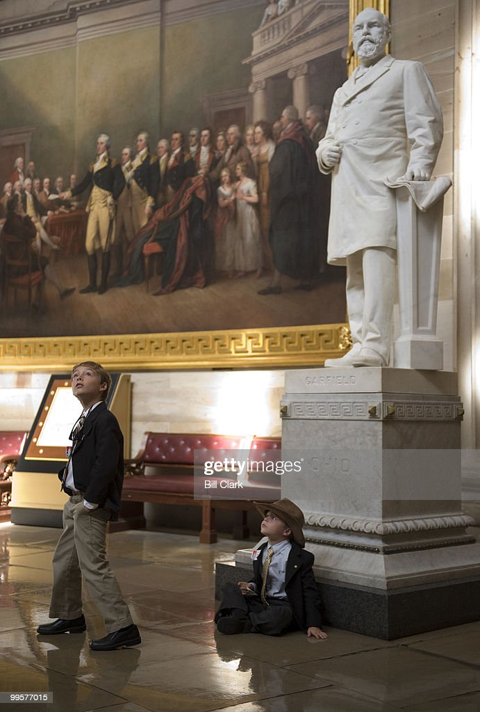 From left, Jack Boekeloo looks up at the Capitol Rotunda as his brother Will sits at the base of the James Garfield statue while on a tour of the Capitol with their parents Lori and Stuart Boekeloo of Benton Harbor, Mich., on Wednesday, Sept. 17, 2008.