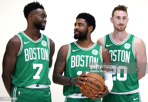 From left Jaylen Brown Kyrie Irving and Gordon Hayward pose for a photo during Boston Celtics Media Day on September 24 2018 in Canton Massachusetts...