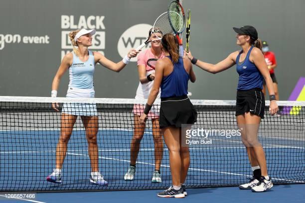 From left, Jil Teichmann of Switzerland, Marie Bouzkova of the Czech Republic, Luisa Stefani of Brazil, and Hayley Carter touch rackets after Stefani...