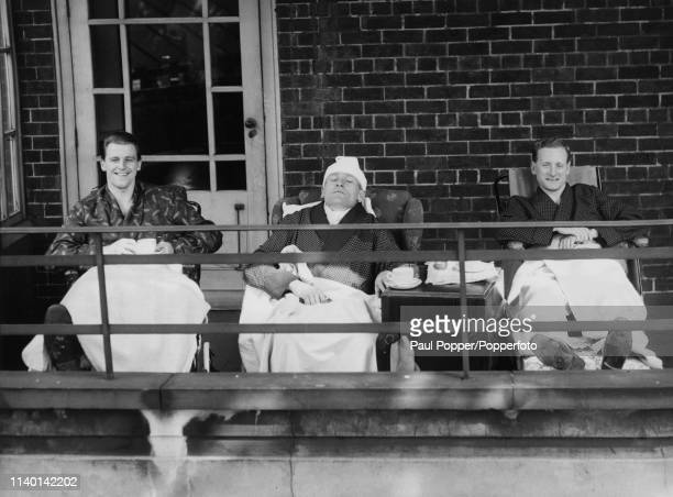 From left, Jimmy Meadows of Manchester City, Bert Trautmann of Manchester City and Tom Finney of Preston North End enjoy the spring sunshine on a...