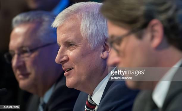 Joachim Herrmann Bavarian Interior Minister Horst Seehofer Bavarian Prime Minister and CSUgeneral secretary Andreas Scheuer speak during a press...