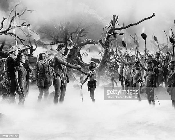 John Buckler Maureen O'Sullivan William Henry Benita Hume and Johnny Weissmuller as Tarzan in 'Tarzan Escapes' directed by Richard Thorpe 1936