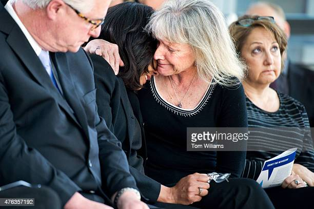 From left John Foley father of slain photojournalist James Foley Nikki Kahn Washington Post photographer and widow of Post photographer Michel...
