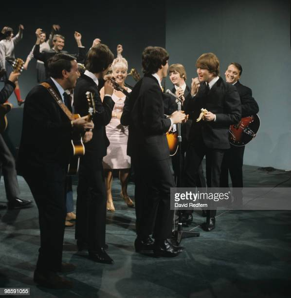From left, John Lennon , Ringo Starr, Paul McCartney and George Harrison of English rock and pop group The Beatles on stage with members of the Karl...