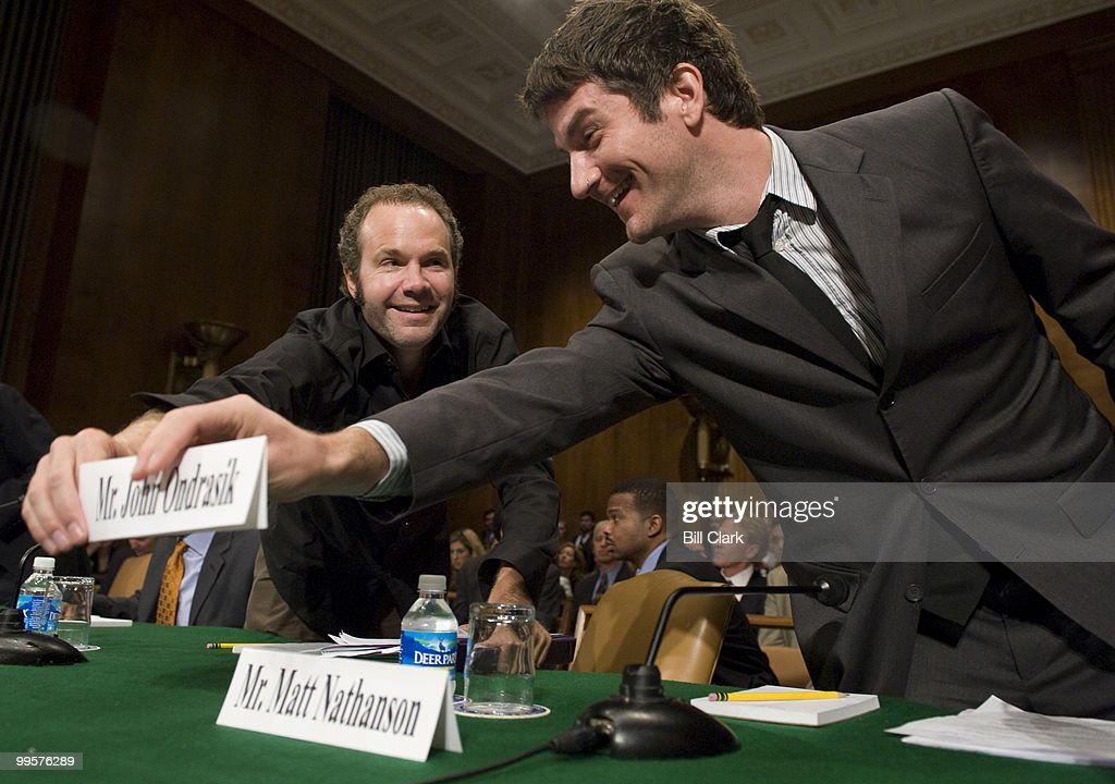 From left, John Ondrasik, singer/songwriter of Five for Fighting, and Matt Nathanson, songwriter and recording artist, switch seats and name plates during the Senate Judiciary Committee hearing on 'Music and Radio in the 21st Century: Assuring Fair Rates and Rules across Platforms,' on Tuesday, July 29, 2008.