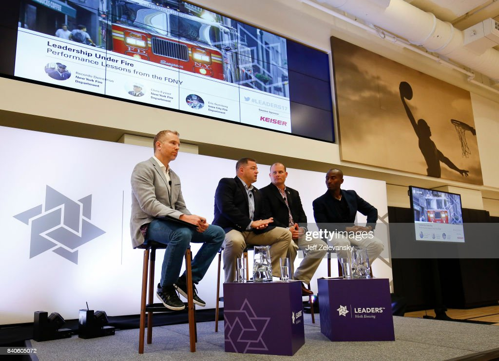 From left, Jonathan Fader leads a discussion on 'Leadership Under Fire' with firefighters Eric Nunberg (2nd, L), Chris Eysser (2nd, R) and Recordo Demetrius (R) at the Leaders Sport Performance Summit on August 29, 2017 in New York City.