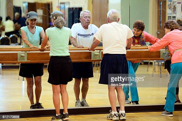 From left Jonelle Apking her husband Ray Apking and Darlene Norris participate in a Parkinson's Foundations class at Douglas H Buck Recreation Center...