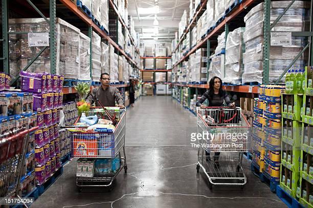 From left Juan Jose Castro and his boss Mayra Guitierrez go shopping at the Costco in Huixquilucan Estado de Mexico outside of Mexico City Mayra said...