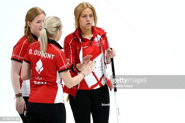 From left Julie Hogh Denise Dupont and Madeleine Dupont of Denmark talk together during the Curling Women's Round Robin Session 4 at Gangneung...