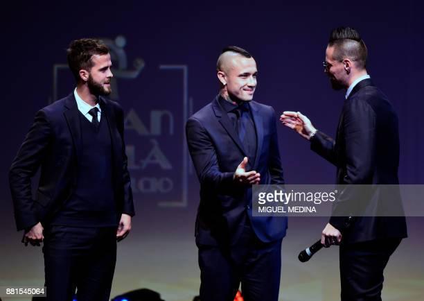Juventus' Bosnian midfielder Miralem Pjanic AS Roma's Belgian midfielder Radja Nainggolan and Napoli's Slovakian midfielder Marek Hamsik attend the...