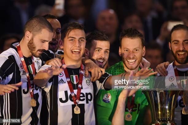 Juventus' defender from Italy Leonardo Bonucci Juventus' forward from Argentina Paulo Dybala Juventus midfielder Miralem Pjanic Juventus' goalkeeper...