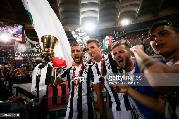 Juventus' defender from Italy Medhi Benatia, Juventus' forward from Croatia Mario Mandzukic, Juventus midfielder from Italy Miralem Pjanic and...