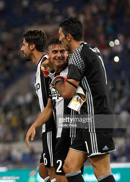 From left Juventus Sami Khedira Paulo Dybala and Gianluigi Buffon celebrate at the end of the Serie A soccer match between Lazio and Juventus at the...