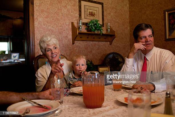 From left Karen Romney sits with her grandson Tyton and brother in law Leighton Romney at Sunday lunch after church service in Colonia Juarez Mexico...