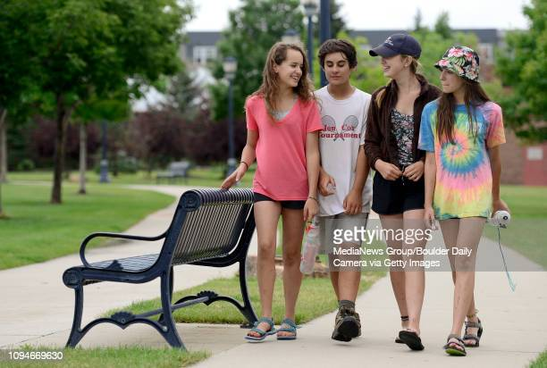 Katya Karabushin Spencer Grimm Jessie Miller and her sister Allie Miller also 13 walk through Roosevelt Park Monday while waiting for Sunset Pool to...