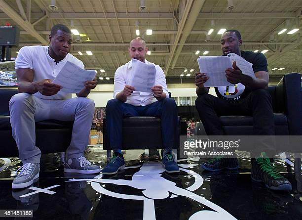 From left Kyle Lowry Demetrius Spencer and Gilbert Arenas go over notes during the 2014 Ball Up Tour on June 28 2014 at the Kentucky International...