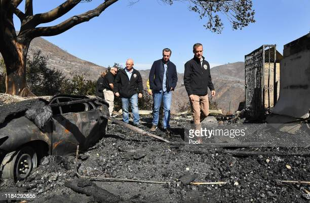 From left LA City Councilman Mike Bonin California Governor Gavin Newsom and LA City Mayor Eric Garcetti tour a burned home along Tigertail Road in...