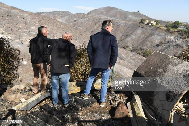 From left LA Mayor Eric Garcetti LA City Councilman Mike Bonin and California Governor Gavin Newsom view a burned and home along Tigertail Road on...