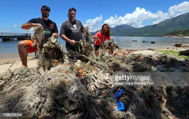 From left lain Brymer Gary Stokes and Adrienne Ng with the nets at Mung Tung Wan near Pui O Lantau 23JUN16 SCMP/ K Y Cheng