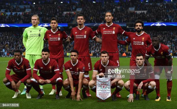 From left Liverpool's Dutch midfielder Georginio Wijnaldum Liverpool's German goalkeeper Loris Karius Liverpool's English midfielder Alex...