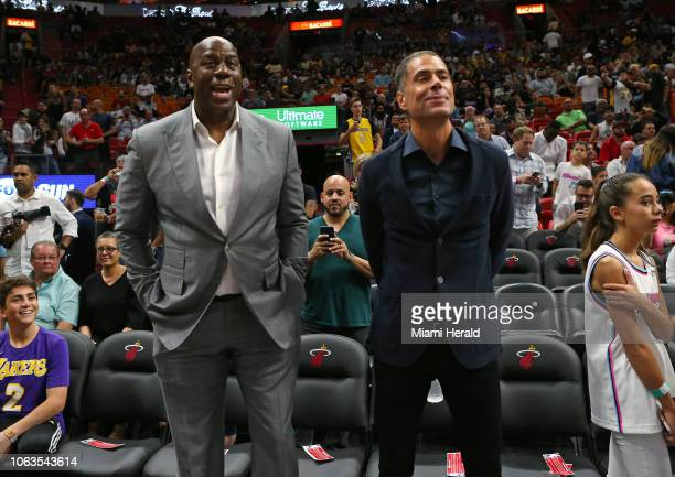 From left Los Angeles Lakers President Magic Johnson and Lakers General Manager Rob Pelinka talking before the start of the game against the Miami...