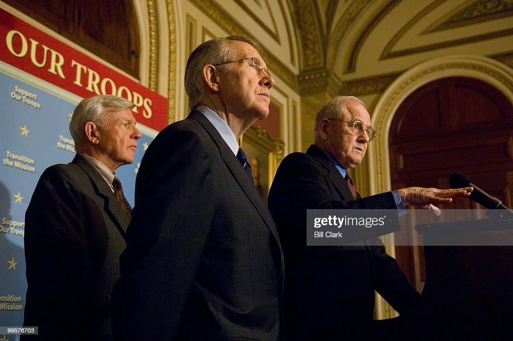 From left, Lt. Gen. Robert G. Gard Jr. (Ret.) and Senate Majority Leader Harry Reid, D-Nev. listen as Brig. General John H. Johns (Ret.) speaks during a news conference on Iraq in the Capitol on Monday, April 16, 2007.
