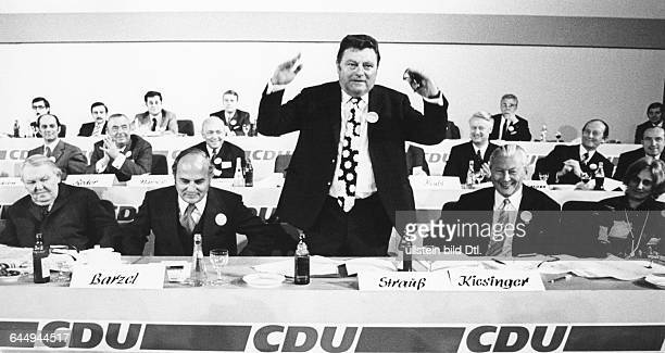 from left Ludwig Erhard Rainer Barzel Franz Josef Strauss Kurt Georg Kiesinger probably at a party conference no further information