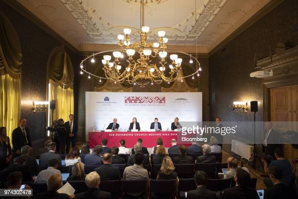 From left Luis de Guindos vice president of the European Central Bank Zoja Razmusa deputy governor of the Bank of Latvia Mario Draghi president of...