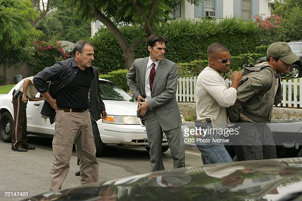 P911 From Left Mandy Patinkin as Jasnon Gideon Thomas Gibson as Special Agent Aaron Hotchner and Shemar Moore as Special Agent Derek Morgan on...