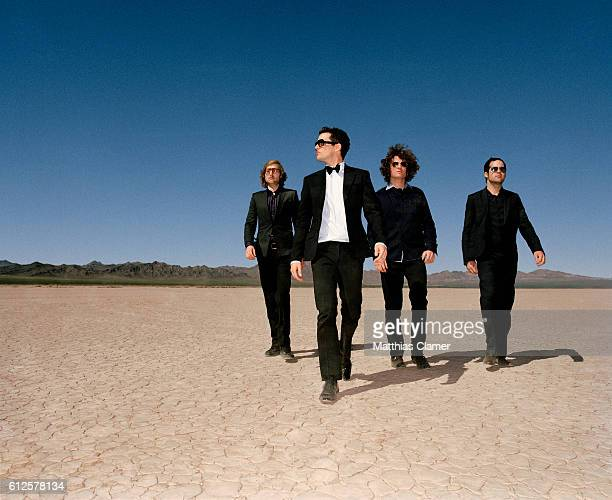 Mark Stoermer, Brandon Flowers, Dave Keuning and Ronnie Vannucci. Styling by Julie Ragolia. Grooming by Kumi Craig. On Brandon, light-blue...