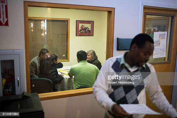 From left married couple Santa and Tika Gurung listen to a Nepali translater as they speak with Vermont Refugee Resettlement Program manager Laurie...