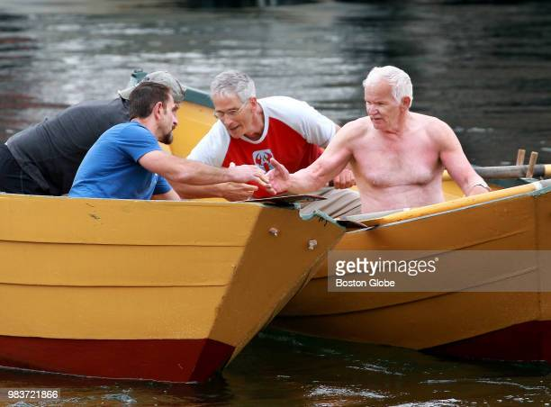 From left Master's Division rowers Mike Harmon John Scola Wilie Wells and Walter Nickerson shake hands after their race during the International Dory...