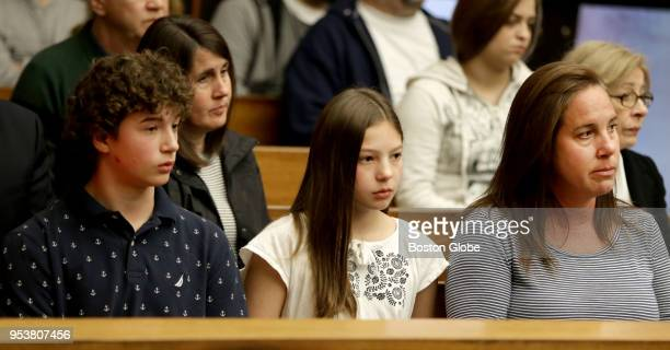 From left Maxwell Weisz sits with his sister Grace Weisz and his mother Alexis Weisz in Woburn District Court during a status hearing for Lynn...