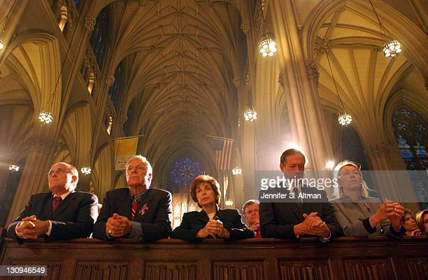 Mayor Giuliani Peter Vallone Vallone's wife Thomas Van Esson Gov Pataki and his wife Libby all pray at St Patrick's Cathedral during a mass held by...