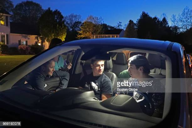 From left Medway High School seniors Meaghan Downing Kenzie Bridges Rob DiGregorio Cameron Conley and Joey Bevilacqua sit in front of the home of a...