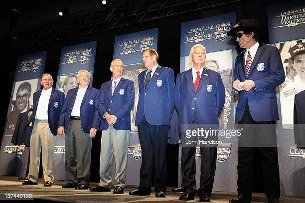 From left Members of the NASCAR Hall of Fame David Pearson Bobby Allison Ned Jarrett Bud Moore Junior Johnson and Richard Petty stand on stage during...