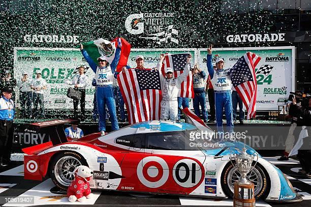 From left Memo Rojas Graham Rahal Joey Hand and Scott Pruett drivers of the TELMEX/Target Chip Ganassi Racing with Felix Sabates BMW Riley celebrate...
