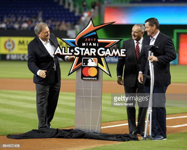 From left Miami Marlins' owner Jeffrey Loria Robert D Manfred Jr and Jeff Conine unveil the official logo of the 2017 AllStar game at Marlins Park...