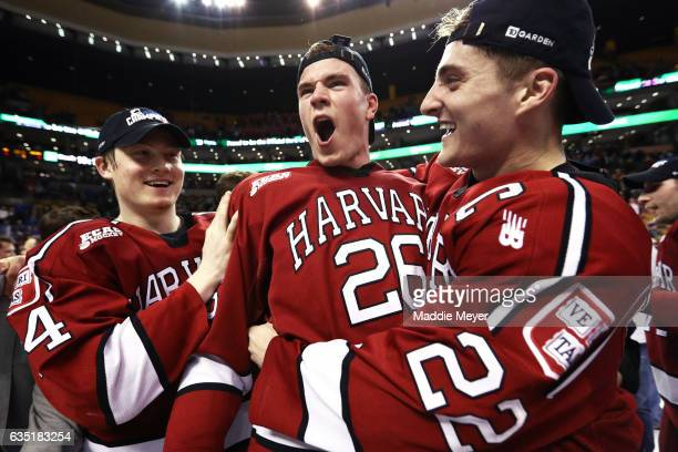From left, Michael Floodstrand of the Harvard Crimson, Jacob Olson and Devin Tringale celebrate after defeating Boston University Terriers 6-3 in the...