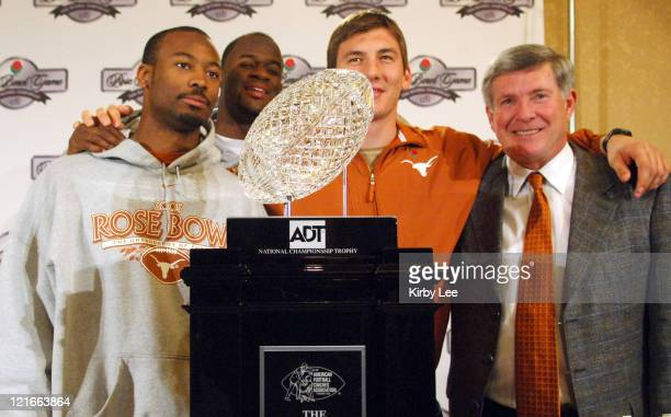 Michael Huff Vince Young David Thomas and Texas cosch Mack Brown pose with the ADT National Championship Trophy at the Beverly Hilton in Beverly...